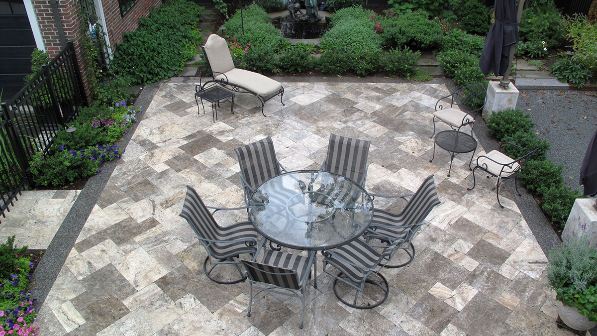 Travertine Patio With Caledonia Granite Border