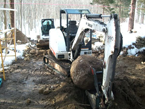 Removing Boulders During Sonotube Excavation
