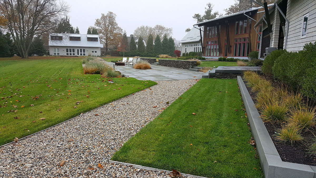 Crushed Stone Paths Connect the Guest and Pool House to the Main Residence