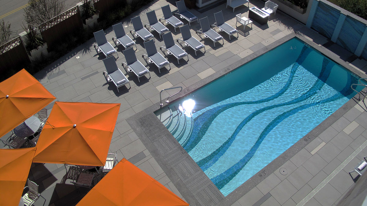 A View of the Pool Patio From the Rooftop Bar