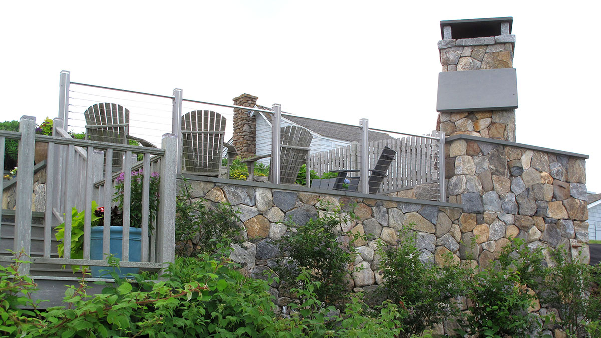 Steel and Wood Railings Blend Seamlessly With the Stone